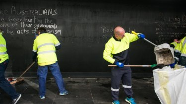 Council staff remove items left by the homeless in Martin Place.