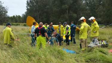 Emergency services at the scene of a fatal plane crash on the Gold Coast.