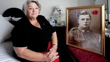 Dawn Dudkowski with a photo her grandfather Thomas Brian.