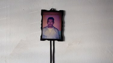 A photograph of the 15-year-old boy's father, who was killed by a gang.