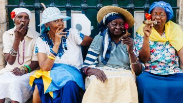 Women enjoying their cigars in Havana. There won't be any new restrictions on the importation into the US of cigars for personal use.