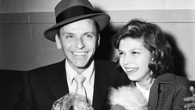 Frank Sinatra arrives in Sydney with his daughter Nancy in January 1955.
