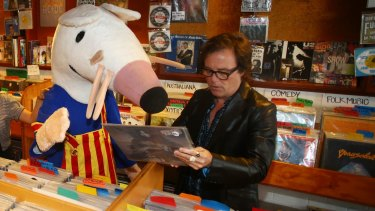 Brad Shepherd of the Hoodoo Gurus helps Maisy the Mouse to pick up some vinyls ahead of Dress Up Attack! festival.