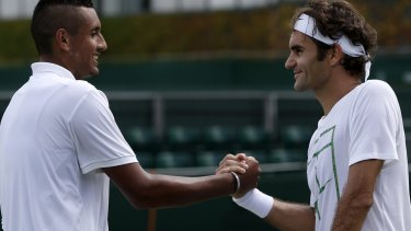 Anti-Fed: Nick Kyrgios shakes hands with Roger Federer after a practice session at Wimbledon.