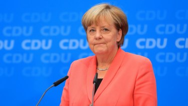 Angela Merkel at a news conference following the CDU's heavy losses.