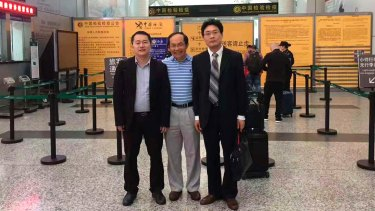 Professor Feng Chongyi at the Guangzhou Airport on Saturday with his lawyers Chen Jingxue, left, and Liu Hao , after being questioned by police.