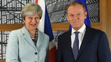 British PM Theresa May walks with European Council President Donald Tusk prior to a meeting at the Europa building in Brussels.