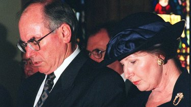 The Prime Minister and his wife Janette in 1996 at a Canberra service to pray for the victims and families of the Port Arthur tragedy.