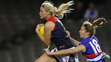 Strong foundations: Tayla Harris of the Demons and Tahlia Randall of the Bulldogs.