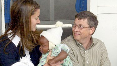 Melinda and Bill Gates with Cecilia Massango during a visit to a research centre in Mozambique in 2003. The couple has been funding malaria research since 2000.
