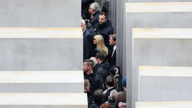 Ivanka Trump is surrounded by police and security as she visits the Memorial to the Murdered Jews of Europe, at the Holocaust Memorial in Berlin.