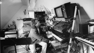 Alan Menken at his electric piano and computer in his home studio in late 1991