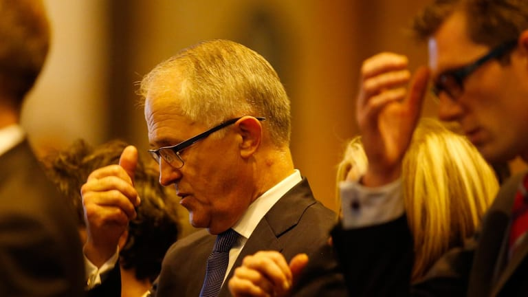 Australian Minister of Communications Malcolm Turnbull attends a mass to pay respect to the victims of the Martin Place siege.