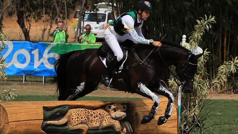 Christopher Burton of Australia riding Santano II clears a jump during the Cross Country Eventing.