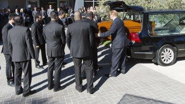 Myruan Sukumaran's coffin arrives at the church ahead of his funeral.