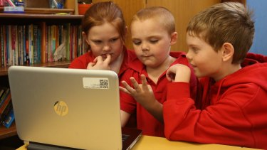 School children work off a computer at Darlington Public School.