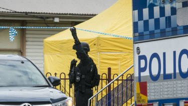 A police officer outside the house raided in  Braybrook.