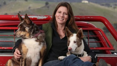 Lynn Davies at her home near Canberra with her dogs Smorgasbord (left) and PooNeck.