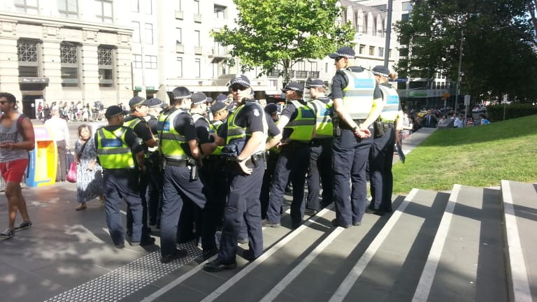 Police opposite Southern Cross Station, at the intersection of Collins and Spencer streets.