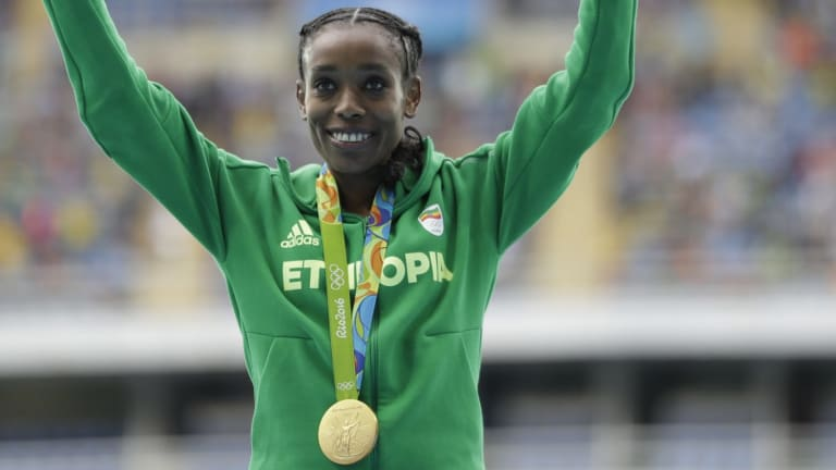 Smashed the world record: Ethiopia's Almaz Ayana celebrates winning the gold medal.