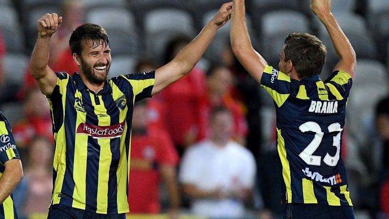 'I won't take it for granted': Golec celebrates a successful penalty with Wout Brama for the Mariners, a club that has allowed him stability after a scarcely believable period in his career.