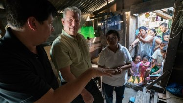 Al Gore (second from left) in Tacloban City, Philippines, discussing the effects of 2013's devastating Typhoon Haiyan.
