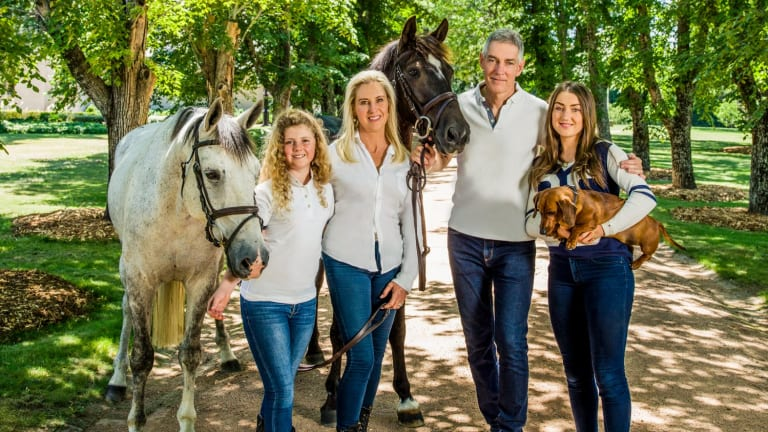The Inglis family (from left), Alexandra, Charlotte, Arthur and Antoinette, with horses Billy the Kid (at left) and His Royal Emblem, and sausage dog Bilbo Baggins.