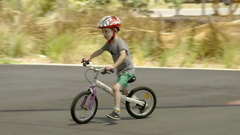 Five-year-old Toby on a balance bike. Unlike most bicycles used by younger children, it doesn't have pedals.