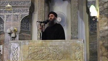 Islamic State leader Abu Bakr al-Baghdadi delivers a sermon in July in Mosul, Iraq.