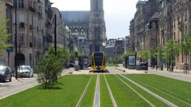 The tramway in Reims, with the cathedral in the background.