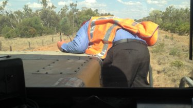 The co-driver of the train took this photo of the colleague climbing onto the bonnet of the train.