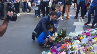 Opposition leader Matthew Guy pays his respects at the makeshift shrine in Bourke Street Mall.