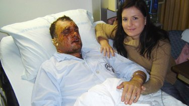 Hanging on: Garth Callender and his fiancée Crystal in Germany following the IED attack.