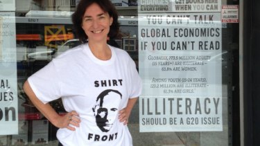 Avid Reader Bookshop owner Fiona Stager wearing the Shirt Front Putin t-shirt.