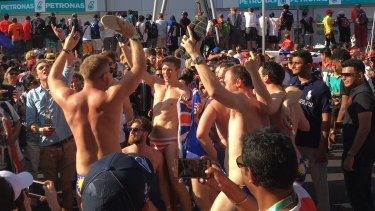 Cheers rose from the crowd on pit straight as the men undressed.