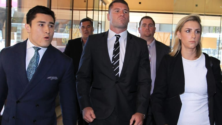 Shaun Kenny-Dowall, centre, arrives at court to face charges relating to his treatment of his former girlfriend, Jessica Peris.