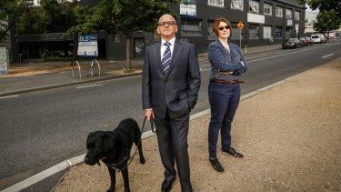 Carlton residents, Dr George Janko and Shern Timmins, have lost the right to be notified of nearby development proposals next door to their homes.
