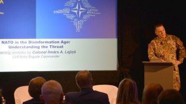 "Colonel Ilmars Atis Lejins speaks at the seminar, ""NATO in the Disinformation Age: Understanding the Threat""."