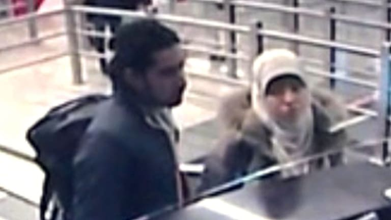 Hayat Boumeddiene (right) presenting her passport at Sabiha Gokcen airport in Istanbul on January 2.