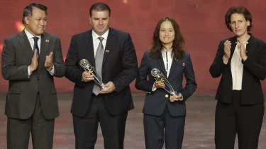Trophy time: Australia's Ange Postecoglou, second left and Japan's Asako Takakura, second right hold their Coach of the year awards during the Asian Football Confederation (AFC) annual awards in New Delhi.