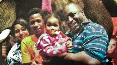 Happier times: Eric Garner and his family.