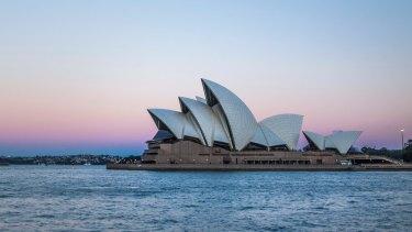 Sydney Opera House at dusk. Photo: Shutterstock.