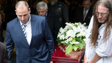 Anthony (at left) and Dave carry out Sallie's coffin.