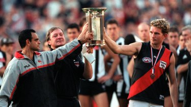 Respect: Michael Long, Kevin Sheedy and James Hird with the Anzac Trophy.
