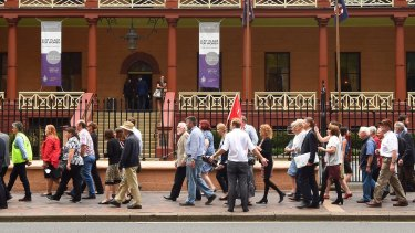 Protesters against the LPI privatisation march on NSW Parliament House on Tuesday.
