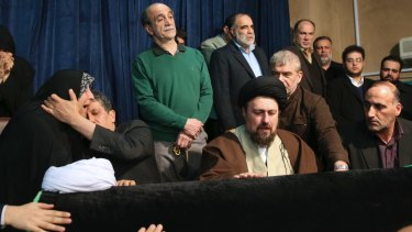 Hassan Khomeini, centre, grandson of Iran's Ayatollah Khomeini, mourns over the coffin of former president Ali Akbar Hashemi Rafsanjani, as Rafsanjani's son Mehdi, second from left, comforts his sister Fatemeh at the Jamaran mosque in Tehran on Sunday.