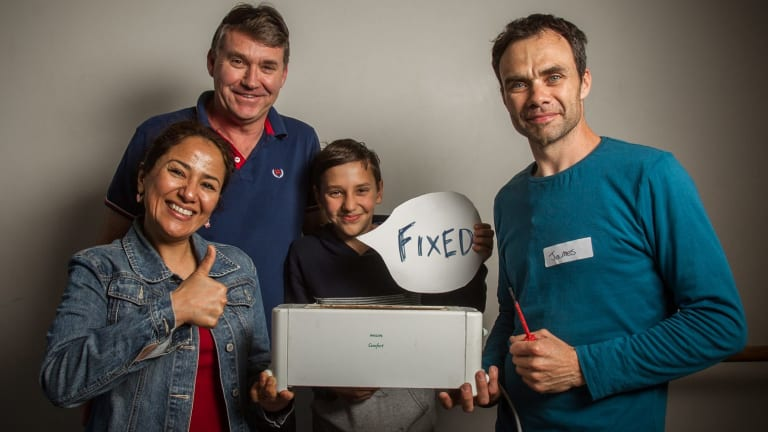 Thank you: Customers, from left, Konika, Peter and Krishan Sadler pose with electrician James Enright, right, who fixed their toaster at Melbourne Repair Cafe in Yarraville.