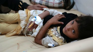 A girl is treated for suspected cholera infection at a hospital in Sanaa, Yemen.