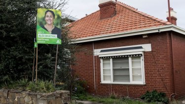 The Greens placard outside the house owned by Labor powerbroker David Feeney.