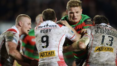 George Burgess runs into a wall of St Helens defenders.